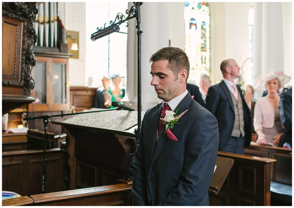 A Groom waiting for his Bride on their wedding day at Ingestre Church, Staffordshire