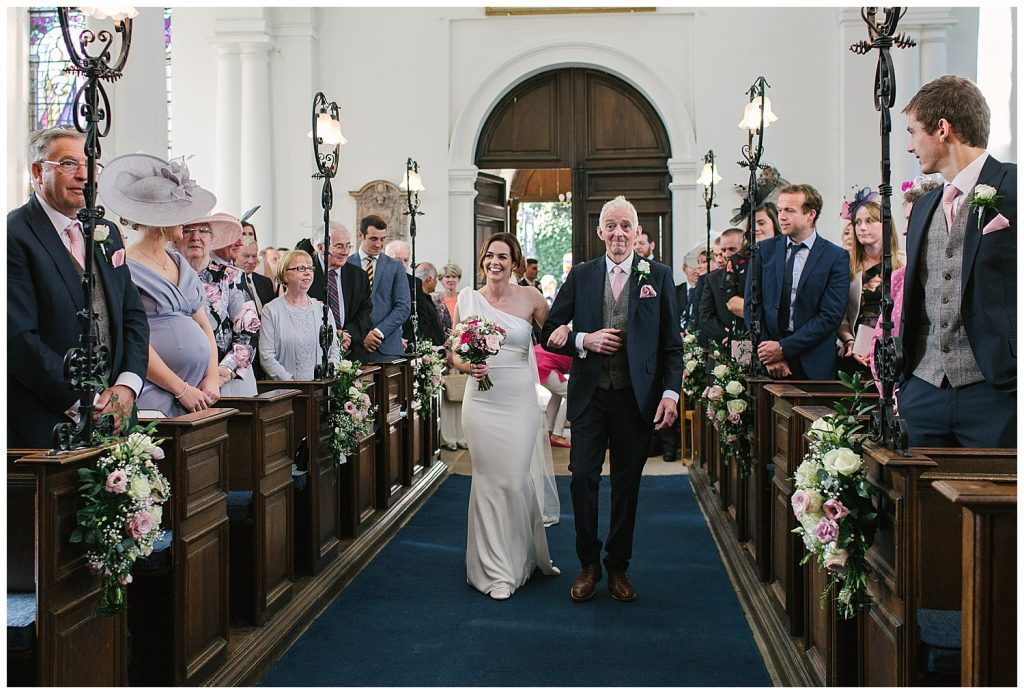 Bride and Father of the Bride walking down the aisle at Ingestre Church