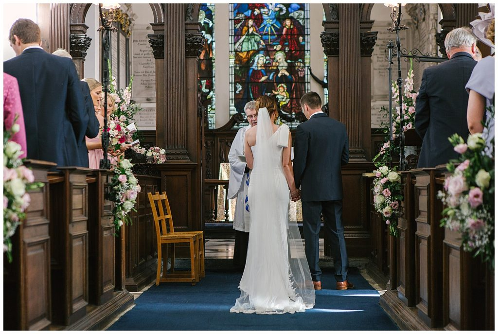 Bride and Groom during their wedding ceremony at Ingestre Church