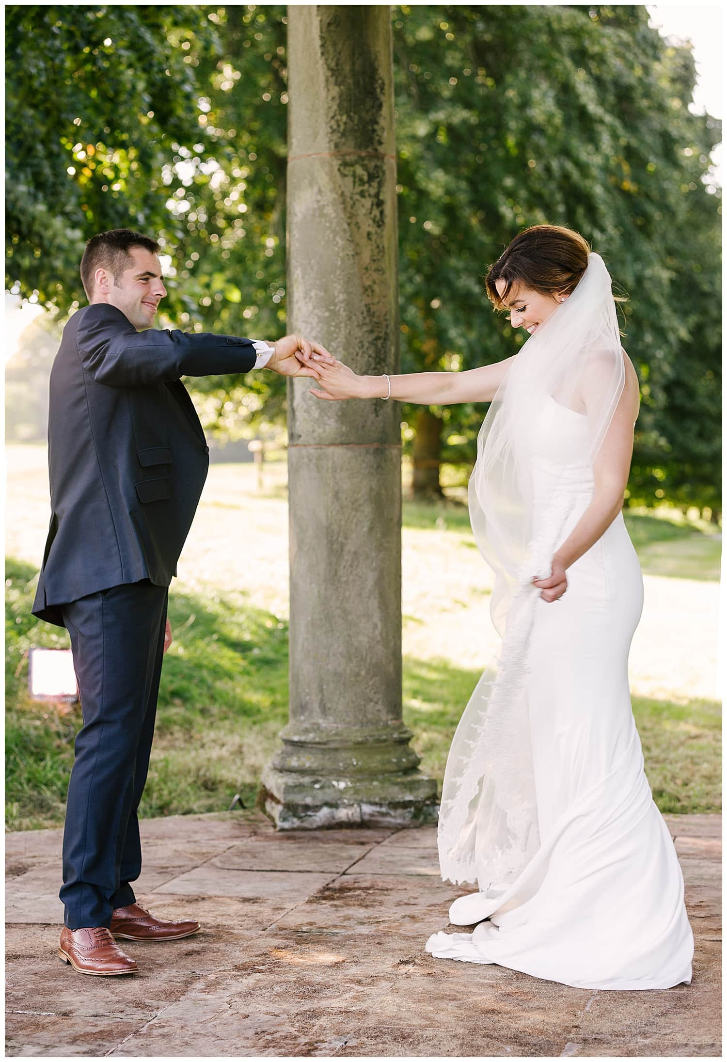 newly married couple practice their first dance at their farm wedding