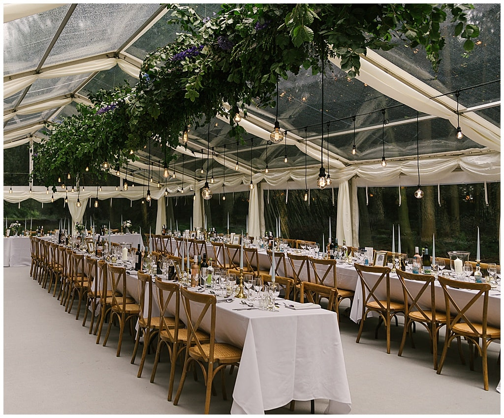 woodland clear marquee reception with Eddison light bulbs