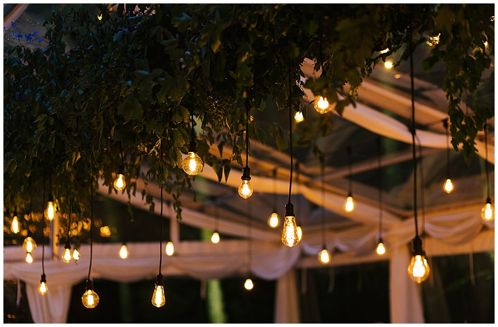 magical atmosphere in wedding marquee with hanging light bulbs