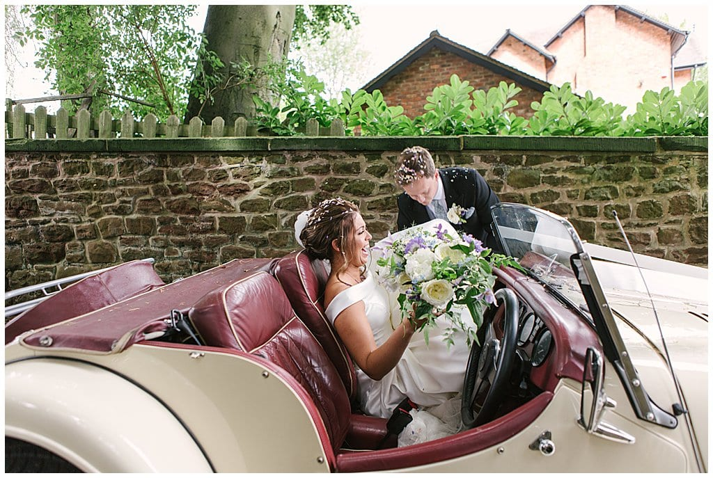 Bride getting into a vintage Morgan | Shropshire wedding photography