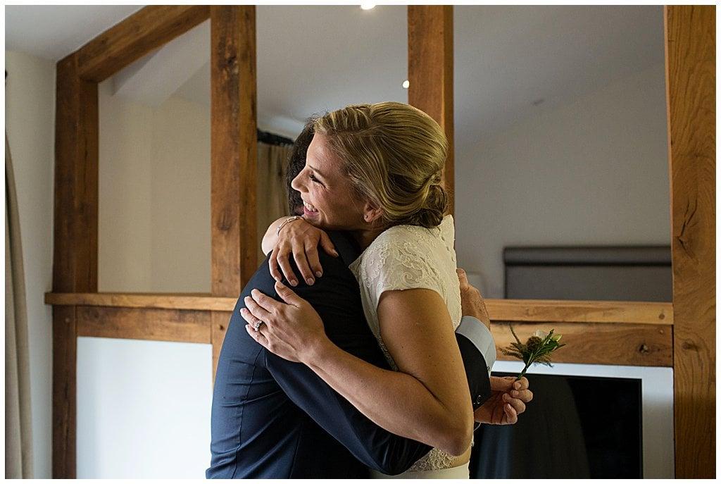 Candid photo of Bride hugging her Dad at Eckington Manor