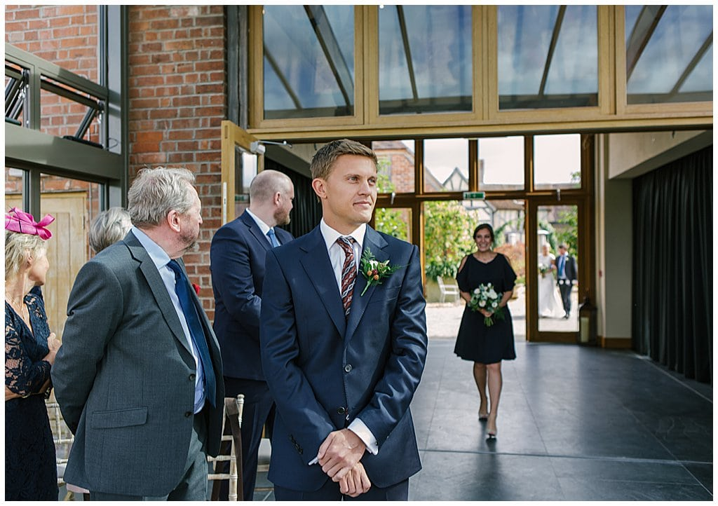 Groom waiting for the Bride to arrive at his Barn wedding in Worcestershire