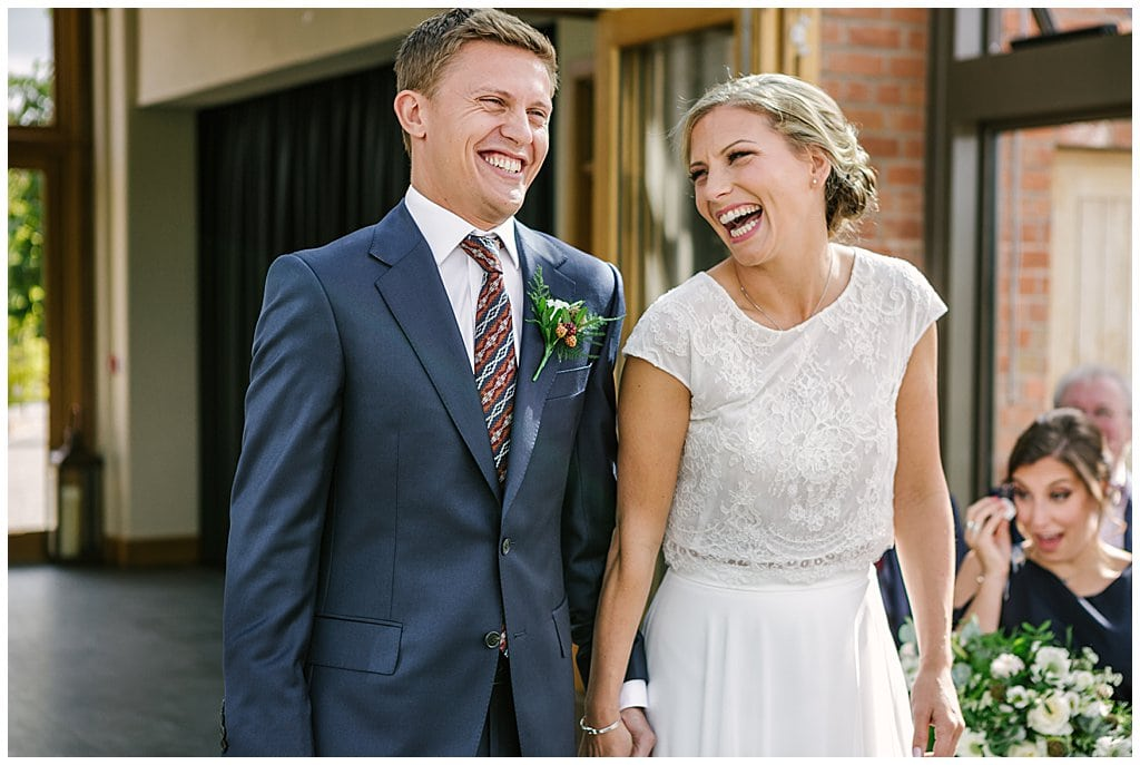 Natural photo of Bride and Groom during their ceremony at Eckington Manor