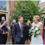 fun coloured confetti photo at a small wedding outside a barn venue in Worcestershire