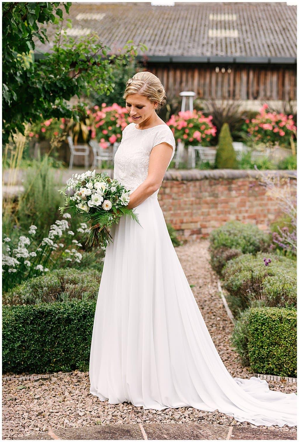Portrait of Bride wearing Dana Bolton wedding dress in the gardens of Eckington Manor