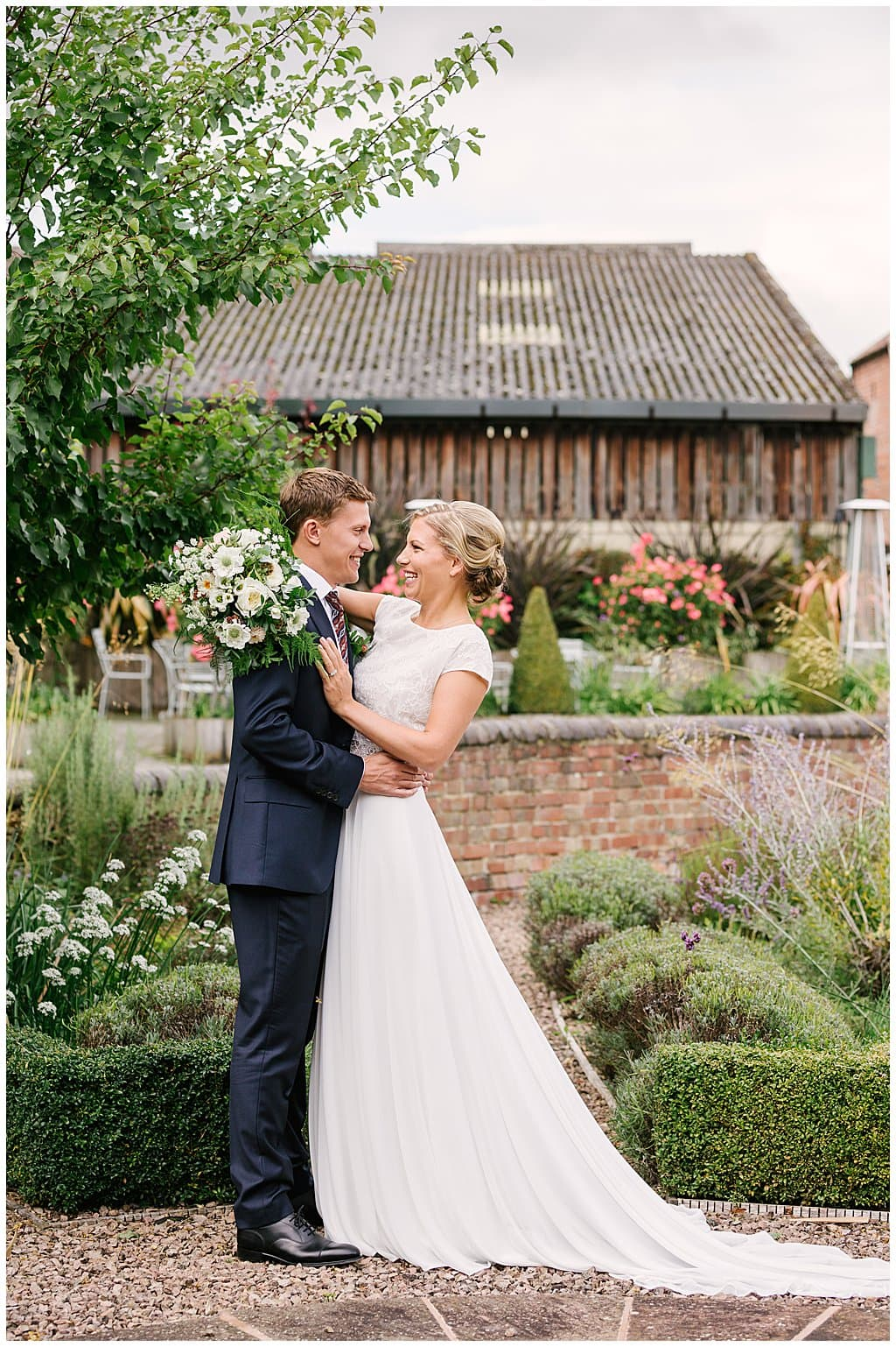 Couple portrait in gardens at a small and intimate wedding in Worcestershire