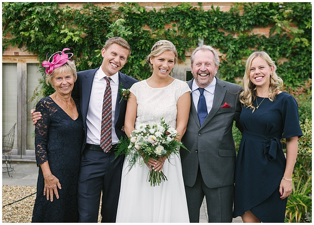 Relaxed, informal family group photo at a Small wedding at Eckington Manor