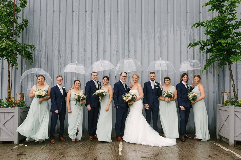 Bridal party photo with umbrellas at Alrewas Hayes